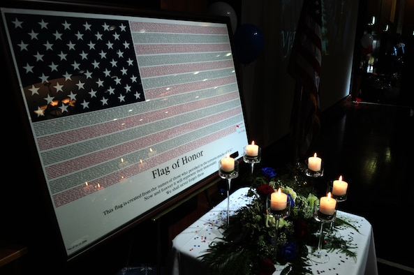 SPANGDAHLEM AIR BASE, Germany – A flag of honor sits on display during the 2011 Air Force Ball Sept. 10 at Club Eifel. The flag is made up of the names of those who died Sept. 11, 2001 as a remembrance of the victims. Saber Airmen from across the 52nd Fighter Wing were invited to attend the event, which celebrated the Air Force's birthday and Airmen's contributions to the current fight. (U.S. Air Force photo/Airman 1st Class Matthew B. Fredericks)