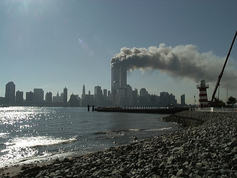 The two towers of the World Trade Center in New York City, burn after being attacked by terrorists Sept. 11, 2001. (Courtesy photo by Mari Schwanke/Released)