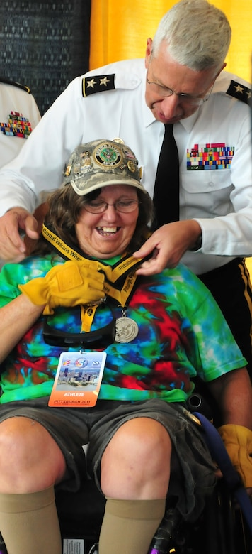 Maj. Gen. Wesley Craig, The Adjutant General of Pennsylvania, helps to award medal recipients during the 31st Annual National Veterans Wheelchair Games held in  Pittsburgh  August 1-6, 2011. (Air Force photo by Master Sgt. Ann Young/Released)