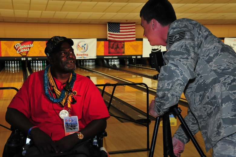 Members of the 171st Air Refueling Wing volunteer to help athletes who participated in the National Veterans Wheelchair Games in Pittsburgh August 1-6, 2011. (Air Force photo by Master Sgt. Ann Young/Released)