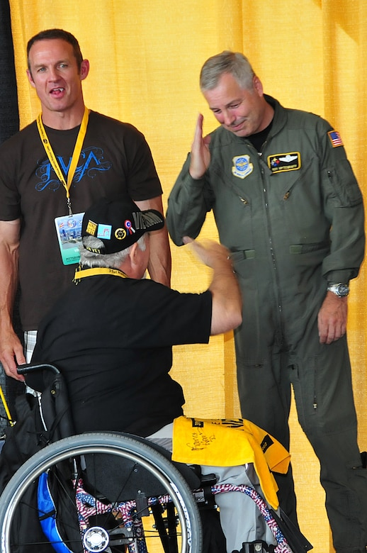 Brig. Gen. Roy Uptegraff, 171st Air Refueling Wing commander, helps to award medal recipients during the 31st Annual National Veterans Wheelchair Games held in  Pittsburgh  August 1-6, 2011. (Air Force photo by Master Sgt. Ann Young/Released)