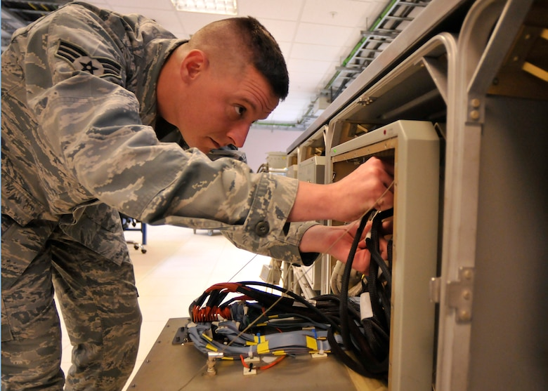 ROYAL AIR FORCE LAKENHEATH, England - Senior Airman Nathan Dimambro, 48th Component Maintenance Squadron Avionics intermediate support section journeyman, performs a function inspection on a Electronic Systems Test Set station at the 48th CMS Avionics Flight AIS building in the ESTS area, Sept. 7, 2011. AIS Airmen are responsible for providing the flightline with highly effective and efficient intermediate support to maintain the electronics on the F-15s. (U.S. Air Force photo/Senior Airman Tiffany M. Deuel)