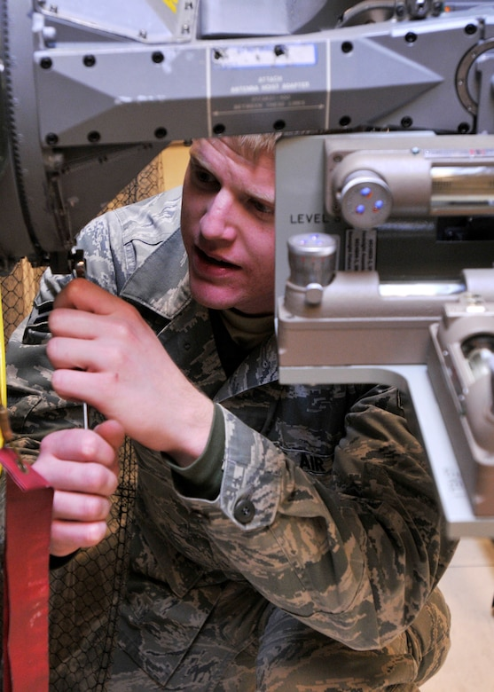 ROYAL AIR FORCE LAKENHEATH, England - Airman 1st Class Chance Bruno, 48th Component Maintenance Squadron Avionics Intermediate Section team member, practices boresight alignment on an F-15 radar antenna, in the Radar section of the 48th CMS Avionics Flight AIS building, Sept. 7, 2011.  AIS Airmen are responsible for providing the flightline with highly effective and efficient intermediate support to maintain the electronics on fighter aircraft. (U.S. Air Force photo by Senior Airman Tiffany M. Deuel)