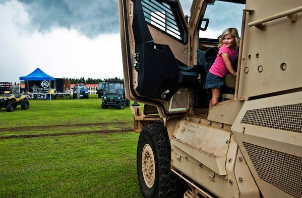 ANDERSEN AIR FORCE BASE, Guam—Skylar Mellan, daughter of Tech. Sgt. Chris Mellan and his wife, Kiley, climbs inside a mine resistant ambush protected vehicle during a showcase for National Preparedness Month here, Sep. 8. Several agencies were on hand demonstrating their capabilities to the Andersen community.  (U.S. Air Force photo by Senior Airman Benjamin Wiseman/Released)