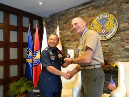 Lt. Gen. Duane D. Thiessen, right, commander of U.S. Marine Corps Forces, Pacific, presents a Marine Corps challenge coin to Maj. Gen. Oscar Rabena, commanding general of the Philippine Air Force, during a visit to the PHAF headquarters at Villamor Air Base, Sept. 15. Thiessen visited the Philippines to meet with the U.S. ambassador, U.S. and Filipino military officials, and component commanders from the Armed Forces of the Philippines.