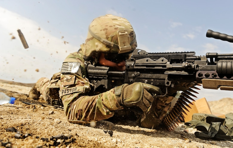 Tech. Sgt. Sam Pastor fires an Mk48 Sept. 10, 2011, at the off-base firing range near Forward Operating Base Mehtar Lam, Afghanistan. Pastor is a vehicle maintainer with the Laghman Provincial Reconstruction Team. (U.S. Air Force photo/Staff Sgt. Ryan Crane)