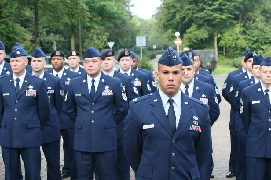VOLKEL AIR BASE, Netherlands -- Airmen stand in formation during a memorial ceremony here Sept. 11. The ceremony was to commemorate 10th anniversary of the Sept. 11, 2001 terrorist attacks on the U.S. Volkel Airmen and members of the Royal Netherlands air force came together to honor those who lost their lives in the 2001 attacks. (U.S. Air Force photo/ Senior Airman Raymond Duesbury)