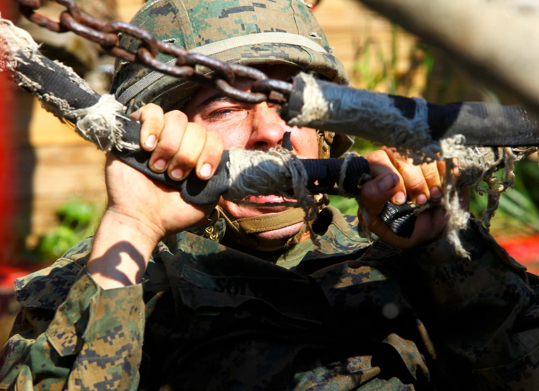 Pfc. Eric Solon, a machine gunner with Weapons Platoon, Charlie Company, 1st Battalion, 2nd Marine Regiment, overcomes an obstacle while conducting a leadership training exercise at the Leadership Reaction Course on Fort Pickett, Va., Sep. 14, 2011. More than 900 Marines and Sailors are taking part in the Deployment for Training exercise at Fort Pickett, Sept. 6-23. The battalion is scheduled to attach to the 24th Marine Expeditionary Unit as its Battalion Landing Team a few days after the training.