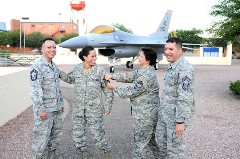 (From the left) Chief Master Sgt. Gil Quiroz, Senior Master Sgt. Sandra Ahern, Chief Master Sgt. Edisa Salcido and Chief Master Sgt. George Silvas gather to congratulate Sergeant Ahern on her pending promotion to the Air Force's highest enlisted rank. The four are graduates from nearby Sunnyside High School. They, like many unit members, represent the wing's connection to the Tucson community and are examples of the career opportunities the Guard offers those who serve. (U.S. Air Force photo/Maj. Gabe Johnson)