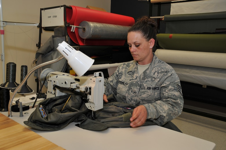 120th Fighter Wing Staff Sgt. Naomy Bottomley works on a piece of flight clothing in the Aircrew Flight Equipment section on June 23, 2011.  (U.S. Air Force photo by Senior Master Sgt. Eric Peterson.)