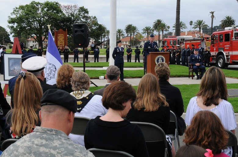 Col. Frank Simcox, 61st ABG commander, speaks at a ceremony marking the 10th Anniversary of the 9-11 terrorist attack, Sept. 11. Members of the Los Angeles and El Segundo police and fire departments participated in the event held at Fort MacArthur. Col. Charles Helwig, Satellite Control and Network Systems Division director, was the keynote speaker.  (Photo by Joe Juarez)