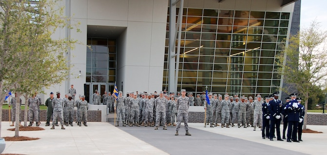 BOSSIER CITY, La. - Members of the Eighth Air Force Headquarters, 608th Air and Space Operations Center and 608th Air Communications Squadron stand in formation for a reveille ceremony at the Cyber Innovation Center in celebration of the Air Force's 64th birthday Sept. 16. Sixty-four years ago, President Harry Truman signed the National Security Act of 1947, establishing the United States Air Force as a separate military service. Since Sept. 18, 1947, the U.S. Air Force – through its Airmen and technology – has played a key role in the defense of the U.S., maintenance of peace and humanitarian operations around the world. (U.S. Air Force photo by Staff Sgt. Brian Stives)