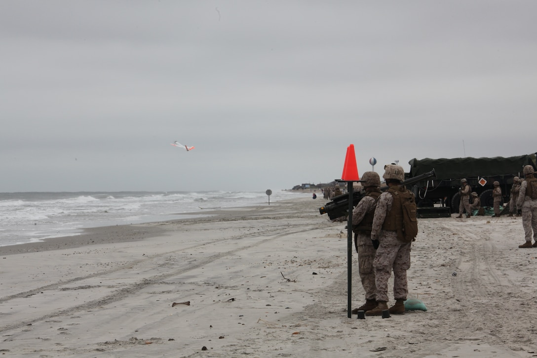 Marines with 2nd Low Altitude Air Defense Battalion watches as an unmanned aerial target launches into its flight pattern on Onslow Beach aboard Marine Corps Base Camp Lejeune, N.C., during 2nd LAAD's live Stinger Missile shoot Sept. 17. The Marines had to conduct several different kinds of training scenarios during the training. They fired at the UATs from static positions; they also conducted quick reaction fires and launched the missile while wearing gas masks.