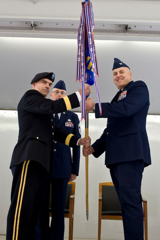 JOINT BASE ELMENDORF-RICHARDSON, Alaska - Col. Donald S. Wenke, the new commander of the 176th Wing, Alaska Air National Guard, accepts the wing guidon from Maj. Gen. Thomas H. Katkus, commander of the Alaska National Guard, during the wing's change of command ceremony Sept. 18, 2011. Wenke assumed command of the wing from Brig. Gen. Charles E. Foster, who has served as the wing commander since 2008. Alaska Air National Guard photo by Master Shannon Oleson.