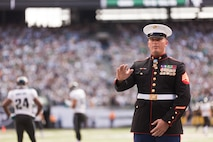 """EAST RUTHERFORD, N.J. --  Sgt. Dakota Meyer, stands on the field while his Medal of Honor citation is read during a television time out in the New York Jets vs Jacksonville Jaguars game, at Metlife Stadium, here, Sept 18. Meyer is the only living Marine to be awarded the Medal of Honor for actions since Vietnam. In 2009, he made multiple trips into an intense firefight to try and save members of his team. Meyer recently announced a campaign to He has also issued a """"Challenge to America"""" to match his efforts and raise an additional $1 million to """"Honor Marines by Educating their Children.""""  This challenge allows Americans to help wounded Marines from all conflicts, especially the past 10 years, and forever change their lives by investing in a Marine student's future. For more information visit, www.dakotameyer.com.  (Official Marine Corps photo by Sgt. Randall A. Clinton / RELEASED)"""