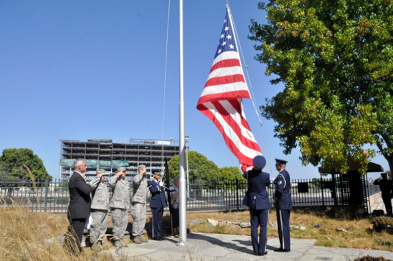 SUNNYVALE, Calif. -Members of the Travis Air Force Base Honor Guard lower the flag during the closing ceremonies at the former Onizuka Air Force Station on Thursday, Sept. 15, 2011.