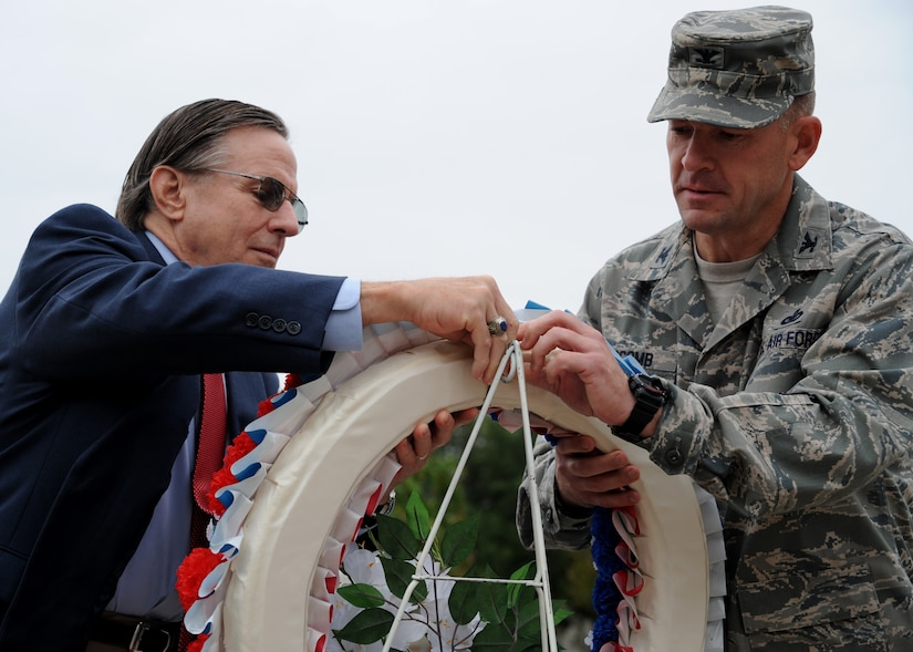 Chuck Jackson and Colonel Richard McComb lay a wreath during the Prisoner of War/Missing in Action retreat ceremony Sept. 16. Mr. Jackson is a former POW and Col. McComb is the 628th Air Base Wing commander. The wreath laying is a gesture of appreciation for our fallen veterans. (U.S. Air Force photo/Staff Sgt. Katie Gieratz) (Released)