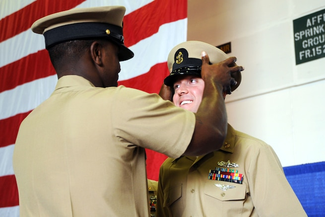 """petty officer of the navy commerce essay In the foyer of the washington navy yard chiefs club hang the portraits of the seven master chief petty officers of the navy on the evening of may 7, 1989, the light over the second mcpon, john """"jack"""" d whittet, flickered briefly, then went out."""