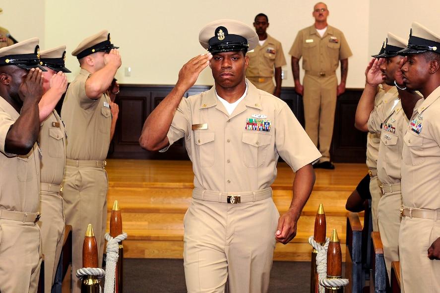 U S  Navy Chief Petty Officer Corey B  Daniel salutes while