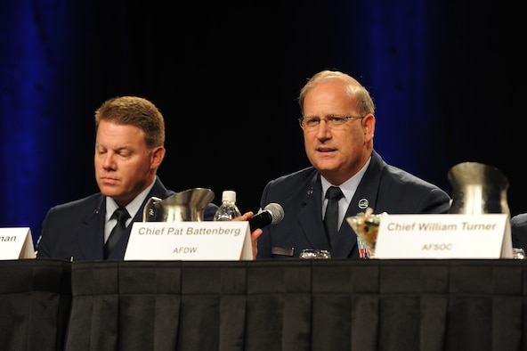 Chief Master Sgt. Eric R. Jaren, the command chief of Air Force Material Command, shares a question from the attendees as moderator of the Command Chief Master Sergeant Forum during the Air Force Association's 2011 Air & Space Conference & Technology Exposition in National Harbor, Md. The forum included (from left to right) Chief Master Sgt. Chris Muncy, the Air National Guard command chief, Chief Master Sgt. Todd Salzman, the Air Force Academy command chief, Chief Master Sgt. Pat Battenberg, the Air Force District of Washington command chief, Chief Master Sgt. William Turner, command chief for Air Force Special Operations Command and Chief Master Sgt. James Cody, command chief for Air Education and Training Command. (U.S. Air Force photo by Airman 1st Class Melissa Goslin)