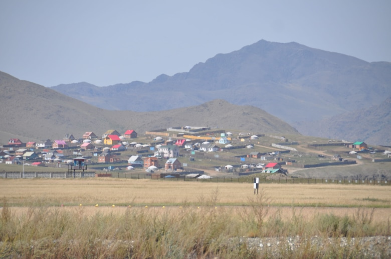 During a space debris retrieval mission in August, 2011, veteran airlift crew members from March Air Reserve Base, Calif., said Mongolia seemed much unchanged since the military's first flight into the country in 1991.  Here a village sits on a hill overlooking the Chinngis Khaan International Airport in Mongolia, Aug. 26, 2011. (U.S. Air Force photo/Master Sgt. Linda Welz)A Mongolian village sits on a hill overlooking the airport where the March C-17 picked up the rocket debris.