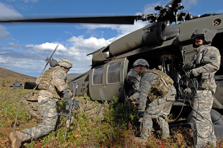 Soldiers from 1st Squadron (Airborne), 40th Cavalry Regiment load a UH-60 Blackhawk helicopter during a training mission near Joint Base Elmendorf-Richardson, Sept. 13. The mission consisted of an air assault, security operations and setting up observation posts. The Soldiers are training in preparation for a deployment to Afghanistan later this year. (U.S. Air Force photo/Staff Sgt. Brian Ferguson)(Released)