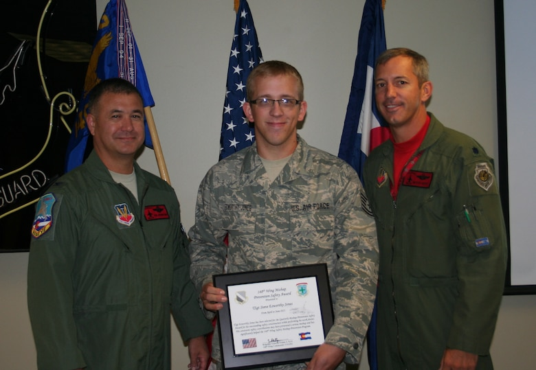 Col. Floyd Dunstan, 140th Wing vice commander, and Lt. Col. Mitchell Neff, 140th Wing chief of safety, present Tech. Sgt. Steve Esworthy-Jones with the Quarterly Mishap Prevention Safety Award for his outstanding safety consciousness while performing his work duties. (U.S. Air Force Photo)