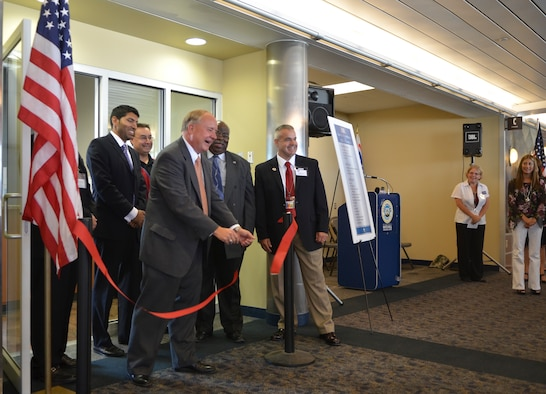 Don Grundy, USO President (right) and major donors to the new USO lounge at General Mitchell International airport, cut the ribbon and mark its official opening on 20 September, 2011. The new 800-square-foot lounge is now a special place in the airport for all veterans, troops and their families looking for a place to relax during travel or before deployment. (US Air Force photo by SMSgt Jeff Rohloff)