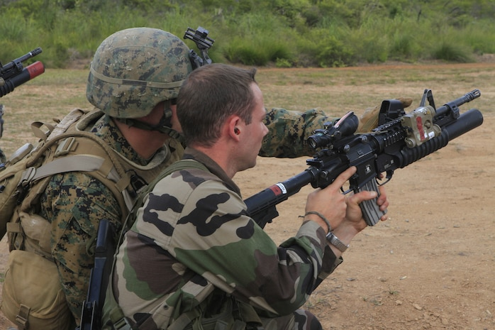 A U.S. Marine with 2nd Battalion, 3rd Marine Regiment, instructs a French armed forces Marine on how to use an M203 grenade launcher at Plum Base Range, New Caledonia, France, Sept. 22, 2011. The 2/3 is participating in Exercise AMERICAL 2011, a platoon-level combat arms combined exchange between the French armed forces, New Caledonia and U.S. Marines with the purpose of maintaining a high level of interoperability, enhancing military-to-military relations and improving mutual combat capabilities with French allies.
