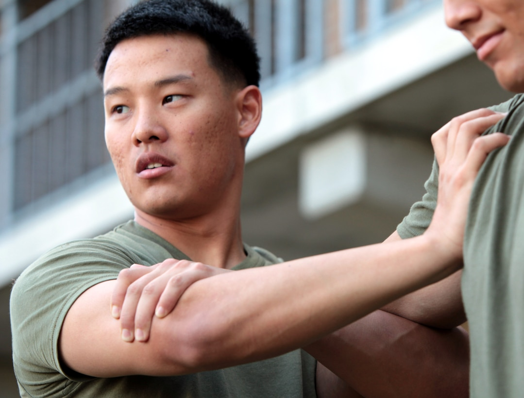 """Sgt. Jason Yoon, 4th platoon guide, Company F, Anti-Terrorism Battalion attached to 2nd Marine Division, prepares to perform a take down while conducting Marine Corps Martial Arts Program training aboard Marine Corps Base Camp Lejeune, N.C., Sept. 22. """"I'm still not certain if we're going to deploy or not,"""" said Yoon """"But either way I'm walking away with my degree in hand and will do whatever it takes to reach my goal and receive a commission as an officer in the Navy."""""""