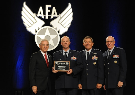 Air Force Academy Chaplain (Capt.) Chad Zielinski receives the Chaplain Corps Award  during the Air Force Association's Air and Space Conference and Technology Exposition Monday in National Harbor, Md. S. Sanford Schlitt, chairman of the AFA board, left, presented the award. Lt. Gen. Mike Gould, Academy superintendent (second from right) and Maj. Gen. Cecil Richardson, Air Force chief of chaplains, are also pictured. (U.S. Air Force photo/Master Sgt. Thomas A. Coney)