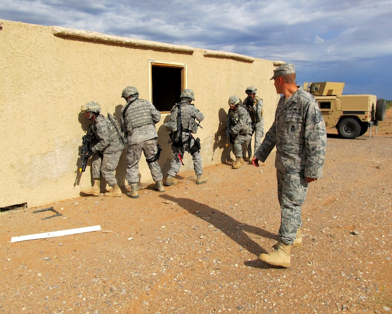 Members of the Texas Air National Guard?s 204th Security Forces Squadron conduct training operations at Fort Bliss, Texas; Sept. 13, 2011. (Air National Guard photo by Staff Sgt. Phil Fountain/Released)
