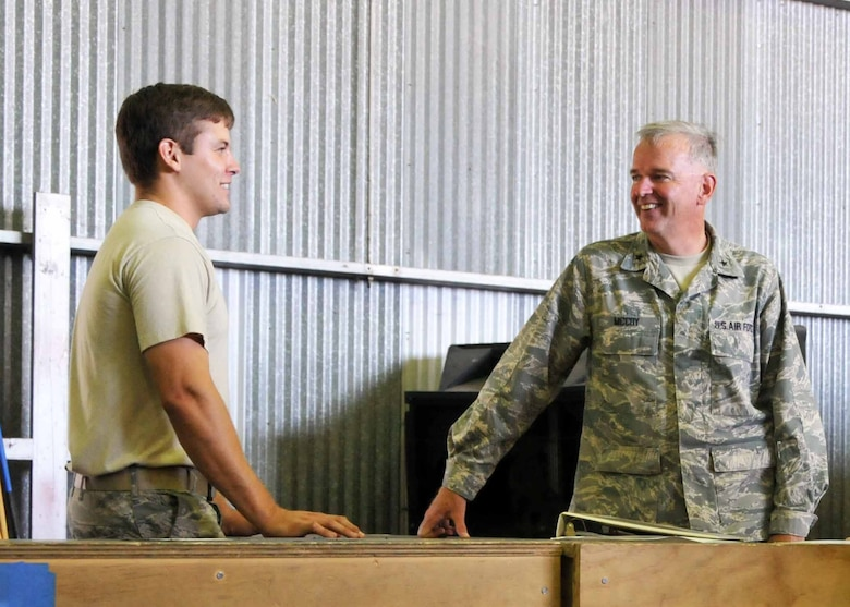 Brig. Gen. John E. McCoy, Assistant Adjutant General for Air, Wisconsin Air National Guard talks with Staff Sgt. Joshua A. Jeter during a visit to the 313th Air Expeditionary Wing in Western Europe on Saturday, July 30, 2011.