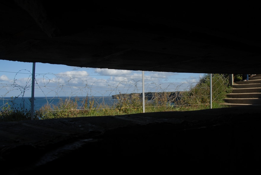 POINTE DU HOC, France -- This is the view Nazi soldiers had from inside this pillbox on D-Day. The 2nd Ranger Battalion climbed sheer, 100-foot cliffs to neutralize the German guns pounding Omaha and Utah Beaches June 6, 1944. Today, the site is a memorial to the Rangers who fought and died there. (U.S. Air Force photo/Senior Master Sgt. Valerie J. Weaver)
