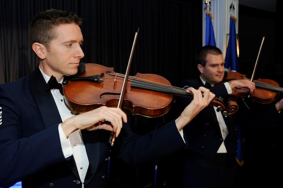 "Master Sgts. Bryce Bunner and Will Hurd and other members of The U.S. Air Force Strolling Strings serenade the audience with ""Somewhere Over the Rainbow."""