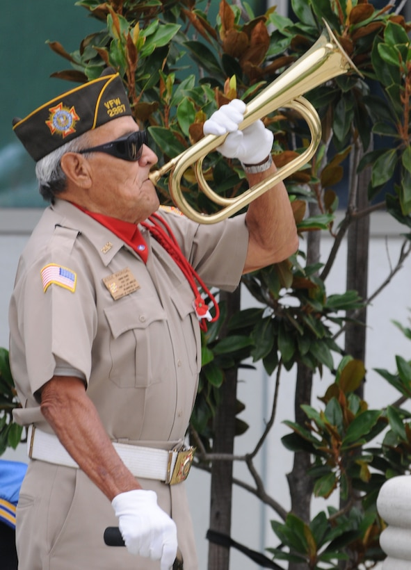 A bugler from VFW Post 2967 plays during the wreath laying ceremony, Sept. 16. (Photo by Joe Juarez)