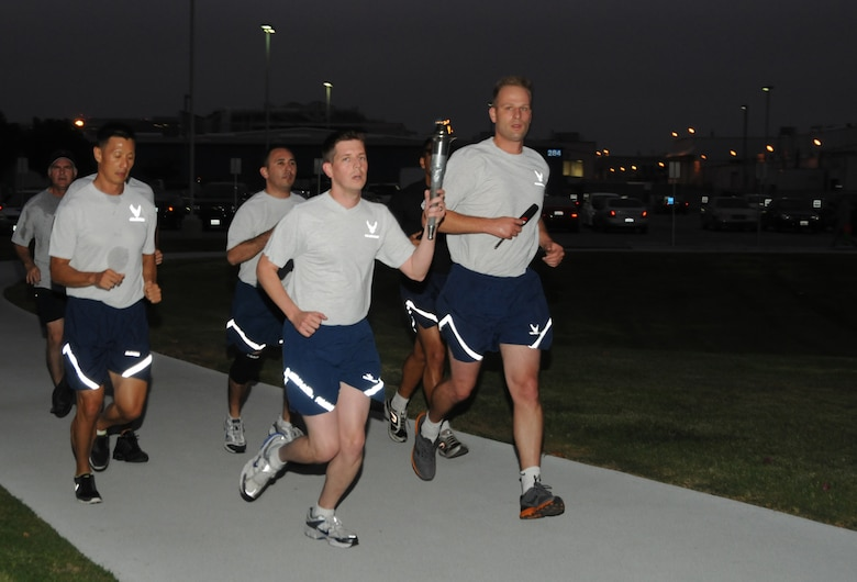Runners ran around the LAAFB track through the night.  (Photo by Joe Juarez)