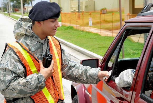 ANDERSEN AIR FORCE BASE, Guam—Airman 1st Class Antonio Prado, 36th Security Forces Squadron member, checks personnel though an entry control point during disaster response exercise MARIANAS RUMBLE here, Sep. 21. Participation in the island-wide exercise tested the wing's ability to respond, evaluate, repair and return to normal operations after an earthquake. (U.S. Air Force photo by Senior Airman Benjamin Wiseman/Released)