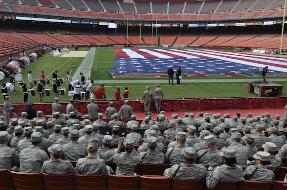 "California Air National Guardsmen from the 129th Rescue Wing at Moffett Federal Airfield, Calif., and Airmen from Travis Air Force Base, in Fairfield, Calif., sit in on the rehearsal for the San Francisco 49ers drum group ""Niner Noise"" at Candlestick Park in San Francisco, Sept. 11, 2011. The Airmen participated in a pre-game flag ceremony to commemorate the tenth anniversary of 9/11 at the 49er 2011 season opener against the Seattle Seahawks. (Air National Guard Photo by Airman 1st Class John Pharr)"