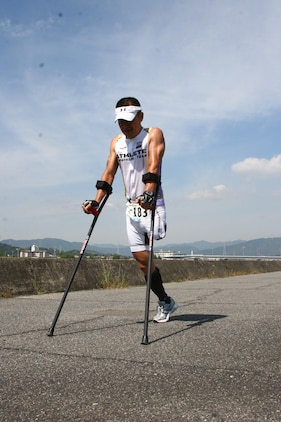 Masafumi Yasul, a triathlon competitor, pushes himself to finish the last running portion of the Marine Corps Community Services Iwakuni Modified Triathlon here Sunday. Yasul lost his leg years ago and continues to compete in triathlons and other races.