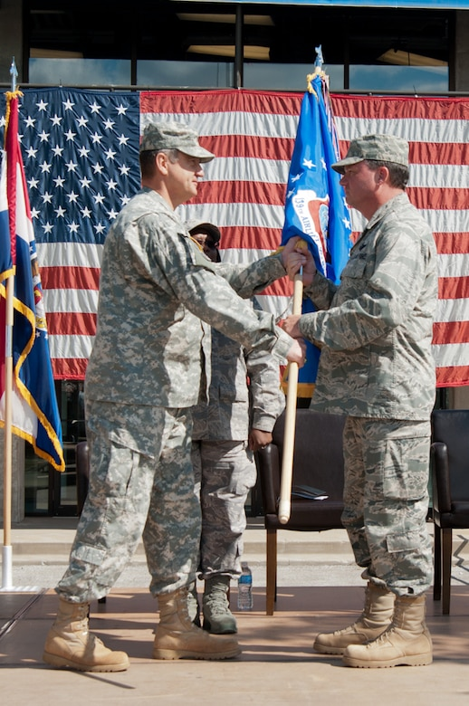 Maj. Gen. Stephen Danner, Missouri National Guard Adjutant General, gives the 139th Airlift Wing flag to Col. Michael Pankau, 139th Airlift Wing Commander Missouri Air National Guard, during the assumption of command on September 25, 2011 at Rosecrans Memorial Airport in Saint Joseph, Mo. Col. Pankau assumed command of the 139th becoming the 10th commander. (U.S. Air Force photo by Senior Airman Sheldon Thompson)