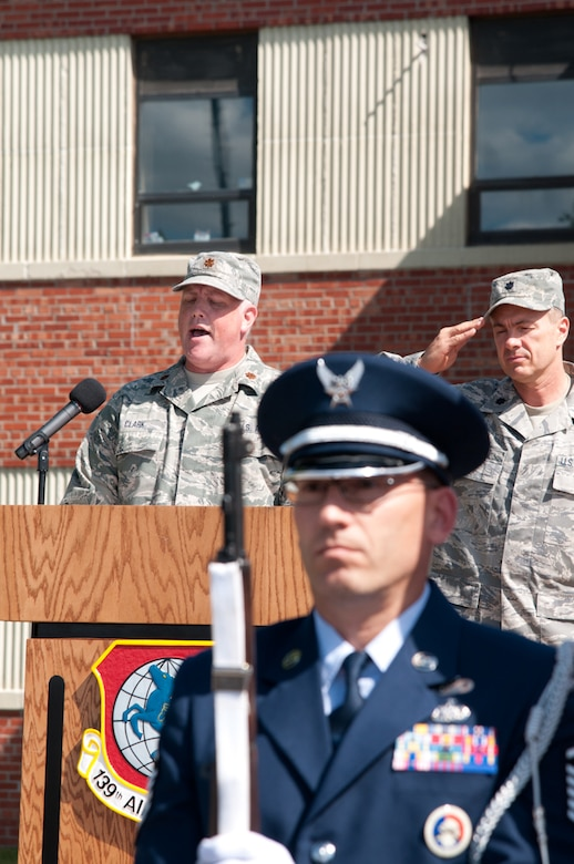 Maj. Brian Clark 139th Airlift Wing, Missouri Air National Guard, sings the National Anthem during an assumption of command ceremony on September 25, 2011 at Rosecrans Memorial Airport in Saint Joseph, Mo. Col. Michael Pankau assumed command of the 139th, becoming the 10th commander. (U.S. Air Force photo by Senior Airman Sheldon Thompson)