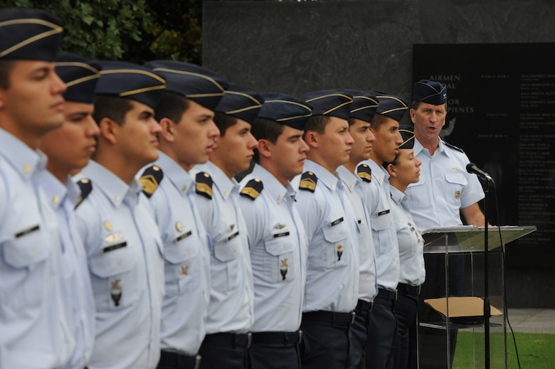 """Col. Tim Carey, deputy director, regional affairs, office of the deputy under secretary of the Air Force, international affairs, speaks to the Colombian Air Force cadets during a wreath laying ceremony at the U.S. Air Force Memorial Sept. 26, Arlington, Va. """"This ceremony honors the Airmen of the U.S. Air Force who served, and those that died in service to their country"""" said Carey. (U.S. Air Force photo by Staff Sgt. Christopher Ruano)"""