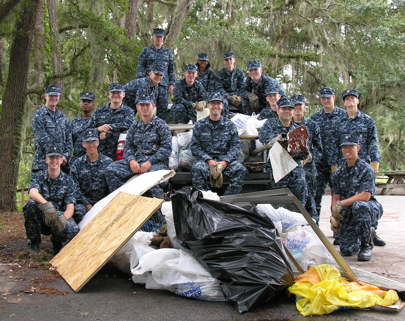 Sailors from Naval Nuclear Power Training Command relax after three hours of cleaning the creeks and riverbeds around Marrington Plantation Sept. 16. The Sailors removed more than 500 pounds of trash and debris from 2.4 miles of Joint Base Chareston - Weapons Station waterways as part of River Sweep, the annual statewide litter clean-up campaign. (U.S. Navy photo/Terrence Larimer)