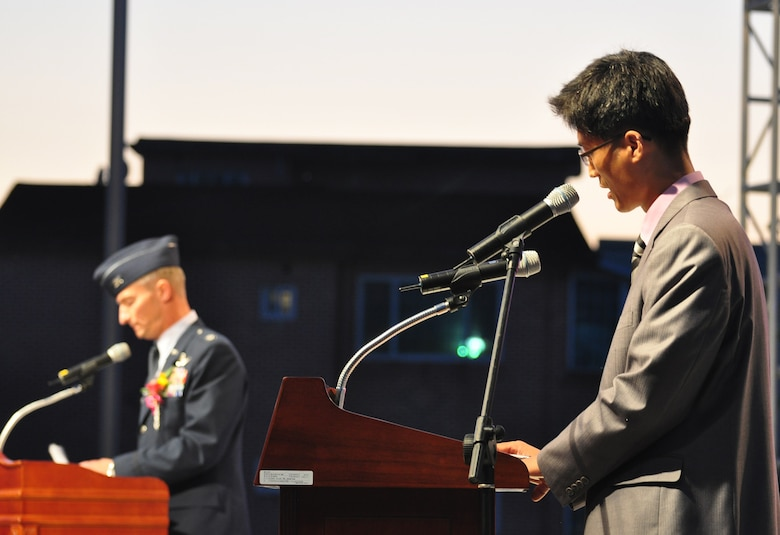 Mr. Pak, Yonghui (right), 51st Fighter Wing Public Affairs, translates for Col. Patrick McKenzie (left), 51st Fighter Wing Commander, during opening remarks Sept. 24, 2011, at the eighth annual Korean American Friendship Cultural Festival. The festival was sponsored by the Songtan Chamber of Commerce and celebrates the great friendship between Koreans and Americans. (U.S. Air Force photo/Tech. Sgt. Chad Thompson)