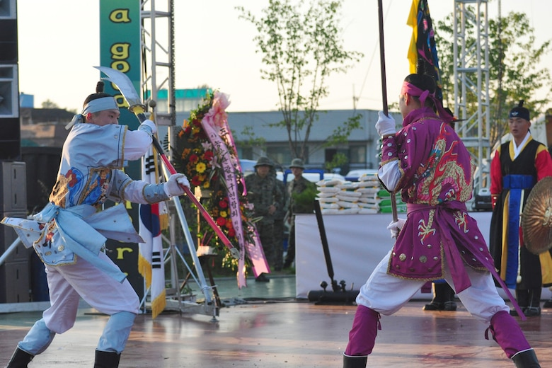 Koreans dressed in traditional military clothing fight during a martial arts performance Sept. 24, 2011, during the eighth annual Korean American Friendship Cultural Festival. The festival was sponsored by the Songtan Chamber of Commerce and celebrates the great friendship between Koreans and Americans. (U.S. Air Force photo/Tech. Sgt. Chad Thompson)