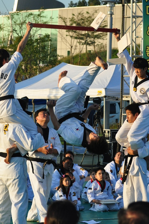 A Taekwondo student flips and breaks a board during a martial arts performance Sept. 24, 2011, during the eighth annual Korean American Friendship Cultural Festival. The festival was sponsored by the Songtan Chamber of Commerce and celebrates the great friendship between Koreans and Americans. (U.S. Air Force photo/Tech. Sgt. Chad Thompson)