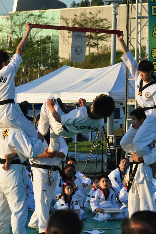 A Taekwondo student flips to break a board during a martial arts performance Sept. 24, 2011, during the eighth annual Korean American Friendship Cultural Festival. The festival was sponsored by the Songtan Chamber of Commerce and celebrates the great friendship between Koreans and Americans. (U.S. Air Force photo/Tech. Sgt. Chad Thompson)