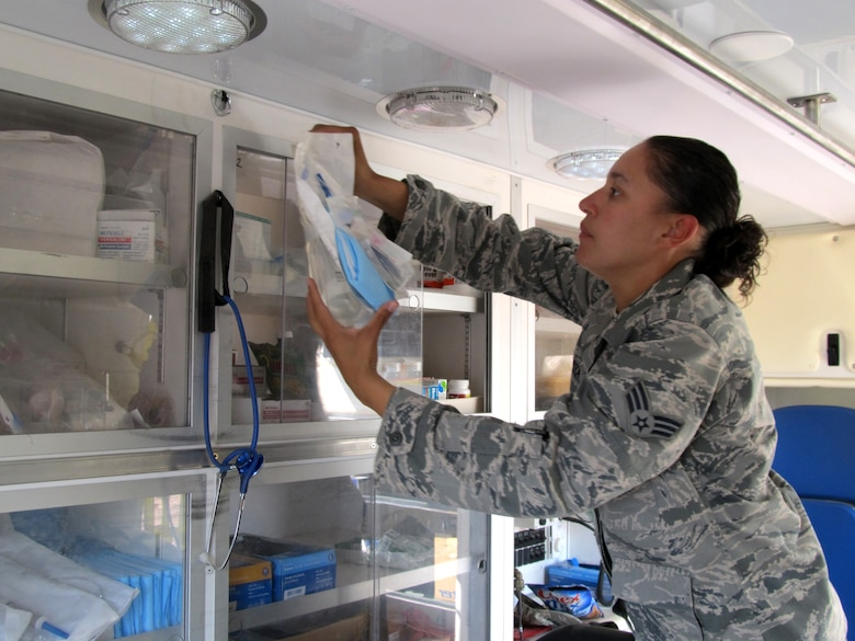 Senior Airman (SrA) Luz Rivera, an aerospace medical technician with the Texas Air National Guard?s 149th Fighter Wing at Lackland Air Force Base, Texas, prepares an ambulance before training operations begin at the Texas Air National Guard?s 204th Security Forces Squadron at Fort Bliss, Texas; Sept. 13, 2011. (Air National Guard photo by Staff Sgt. Phil Fountain/Released)