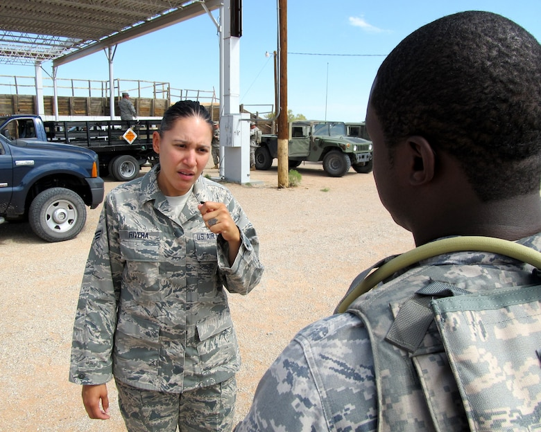 Senior Airman (SrA) Luz Rivera, an aerospace medical technician with the Texas Air National Guard?s 149th Fighter Wing at Lackland Air Force Base, Texas, visits with a student before training operations begin at the Texas Air National Guard?s 204th Security Forces Squadron at Fort Bliss, Texas; Sept. 13, 2011. (Air National Guard photo by Staff Sgt. Phil Fountain/Released)